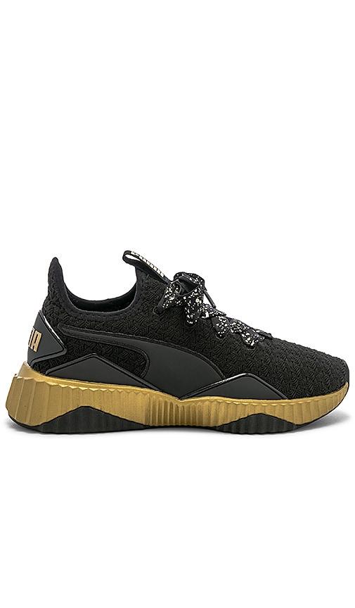 Puma Defy Sparkle Sneaker in Puma Black   Puma Team Gold  93b4ceb33