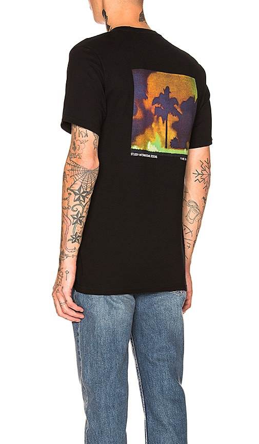 baadea73a68 Fire On Babylon Tee. Fire On Babylon Tee. Stussy