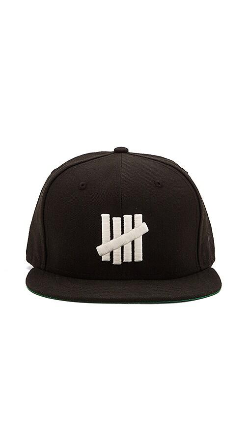 Undefeated 5 Strike Glow New Era Hat in Black