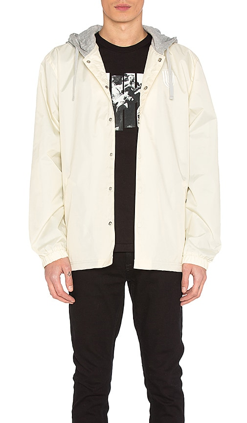 Undefeated Hooded Coaches Jacket in Ivory