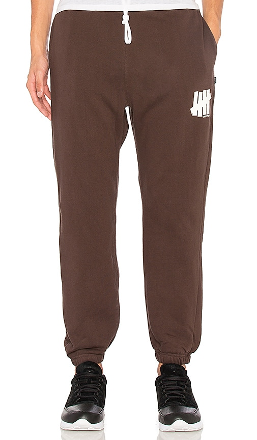 Undefeated 5 Strike Sweatpant in Brown