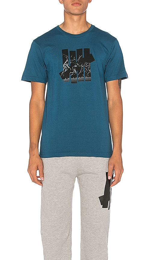 Undefeated Acceleration Strike Tee in Blue
