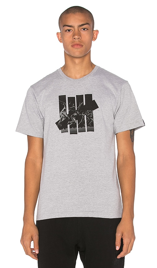 Undefeated Acceleration Strike Tee in Gray