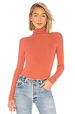 Enza Costa Rib Fitted Turtleneck Top in Terracotta