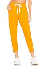 Splits59 Reena 7/8 Pant in Bright Orange & Off White