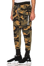 The North Face NSE Graphic Pant in Burnt Oliver Green Woods Camo Print