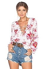 x REVOLVE Lace Up Blouse en Fuchsia Bloom