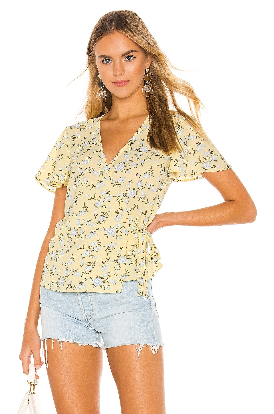 1.state Shorts 1. STATE SHORT SLEEVE WRAP FRONT BLOSSOM CLUSTER BLOUSE IN YELLOW.