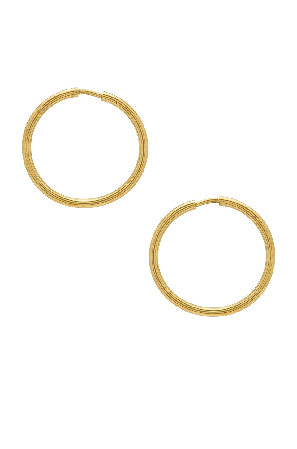 APRES JEWELRY Baby Wire Hoops in Metallic Gold