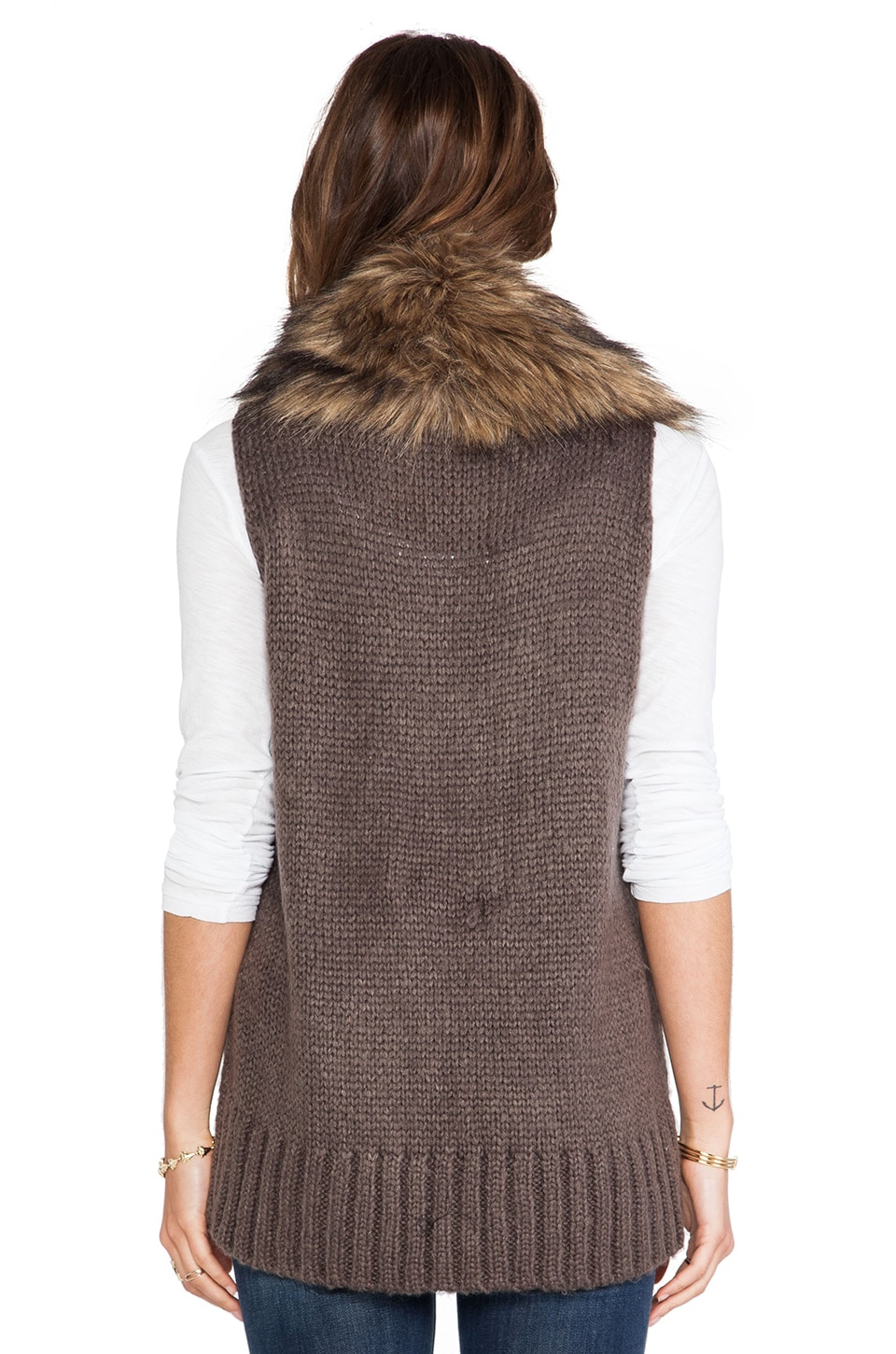 Beautiful white faux fur vest with genuine leather trim Cinched waist detail makes it super feminine Peplum bottom No size tag but fits like a Medium/Large & waist can be adjusted. YMI (W) Women's Small Blue Vest Puffer Zip Up Faux Fur Trim. $ Buy It Now. or Best Offer.