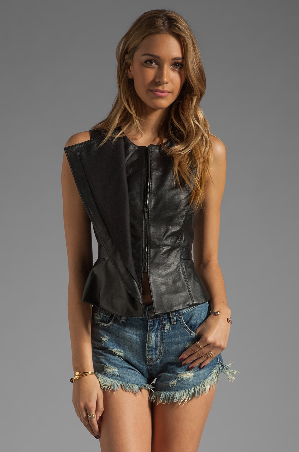 BCBGMAXAZRIA Leather Peplum Top in Black