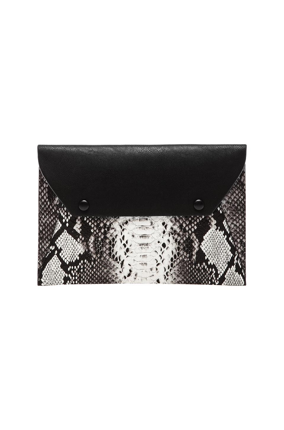 BCBGMAXAZRIA Printed Snake Envelope W/ Covered Snaps in Black & White