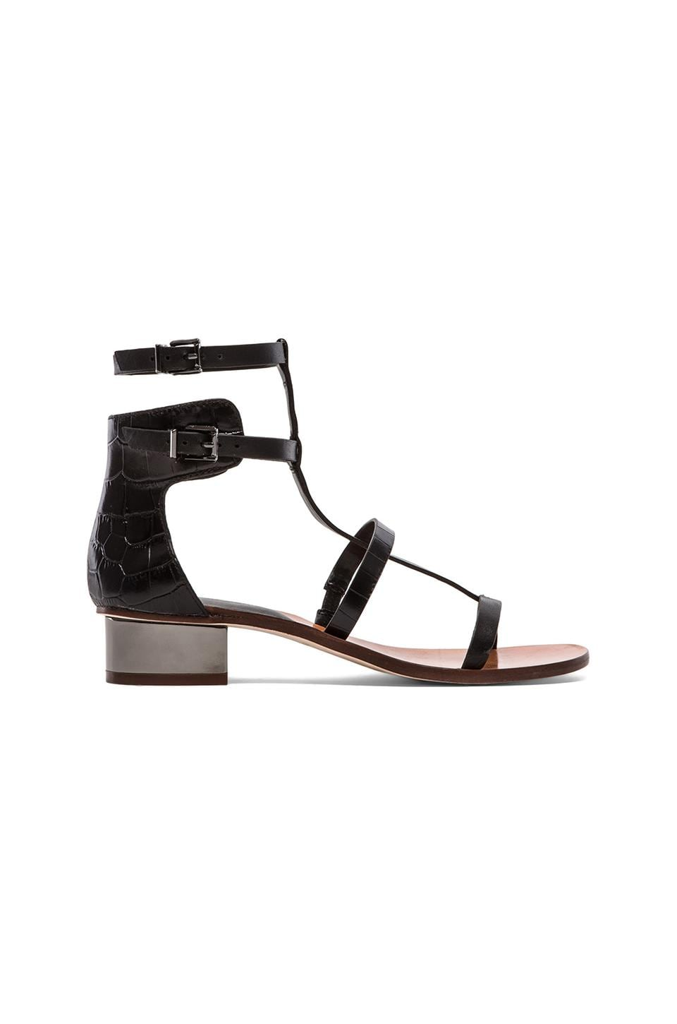 BCBGMAXAZRIA Cross Sandals in Black