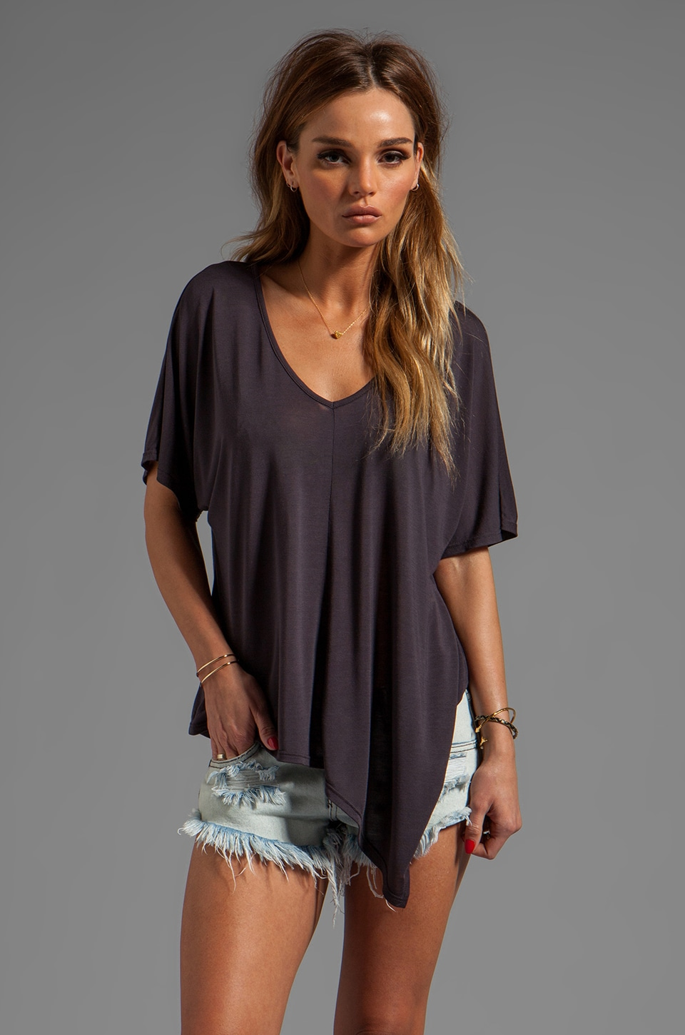 Blue Life Uneven Hem Top in Faded Black