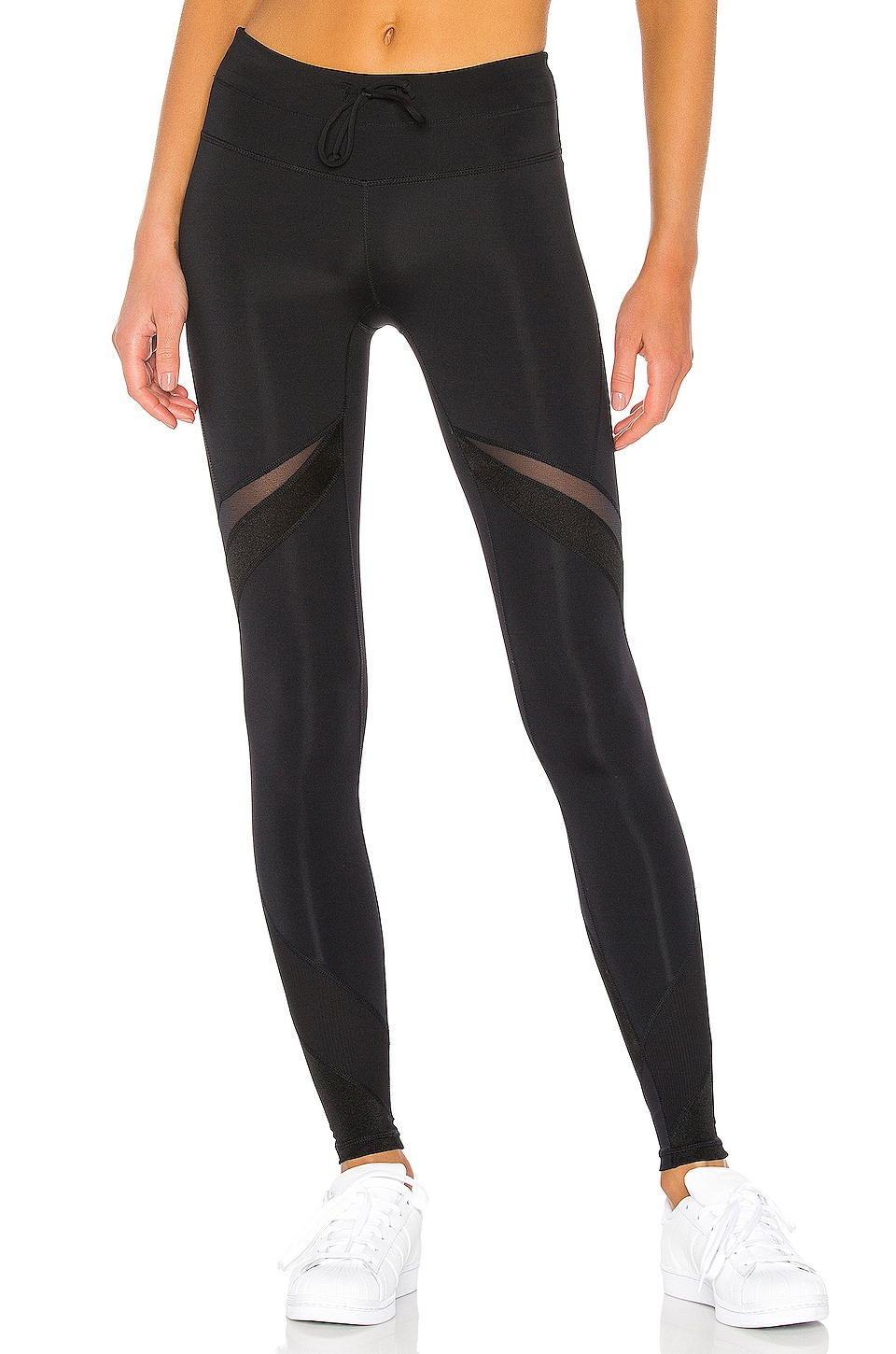 Free People X FP Movement Mid Rise Tap Back Legging in Black