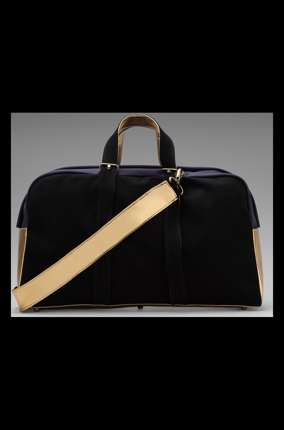 Haerfest Overnight Duffle in Black/ Gold/ Black