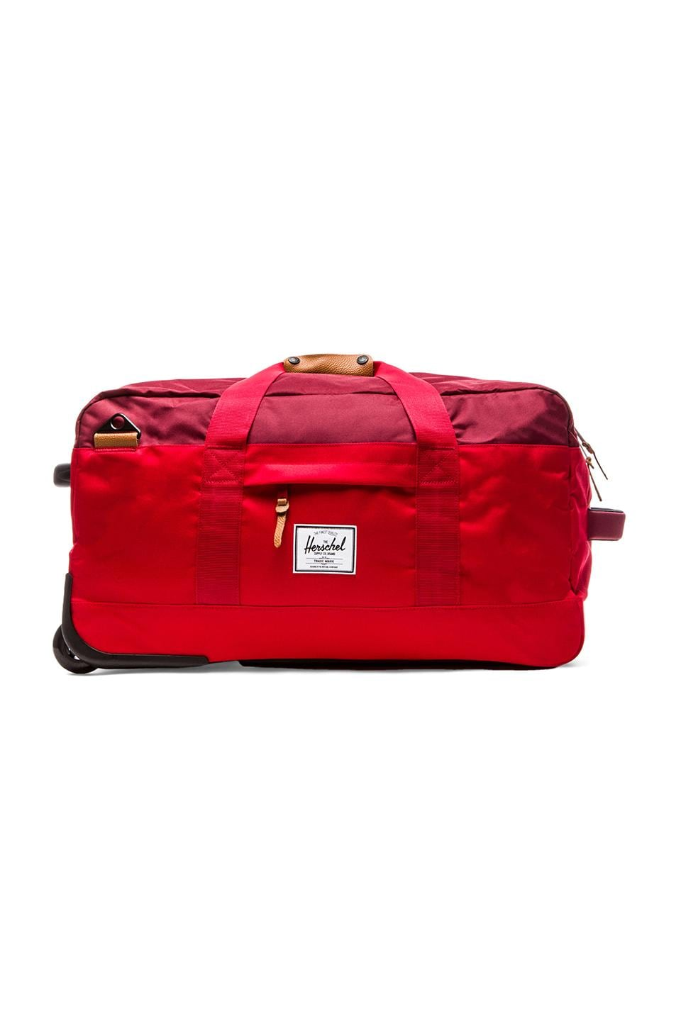 Herschel Supply Co. Wheelie Outfitter Duffle in Red & Burgundy & Rust