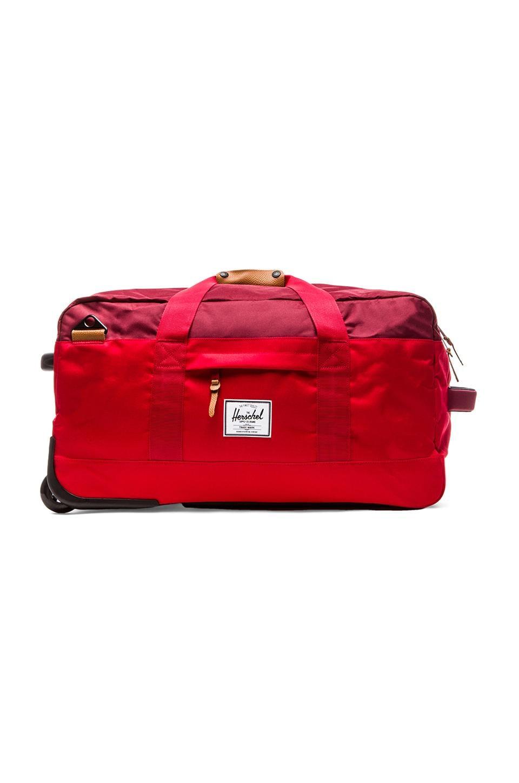 Herschel Supply Co. Wheelie Outfitter Duffle in Red & Burgundy & Rust