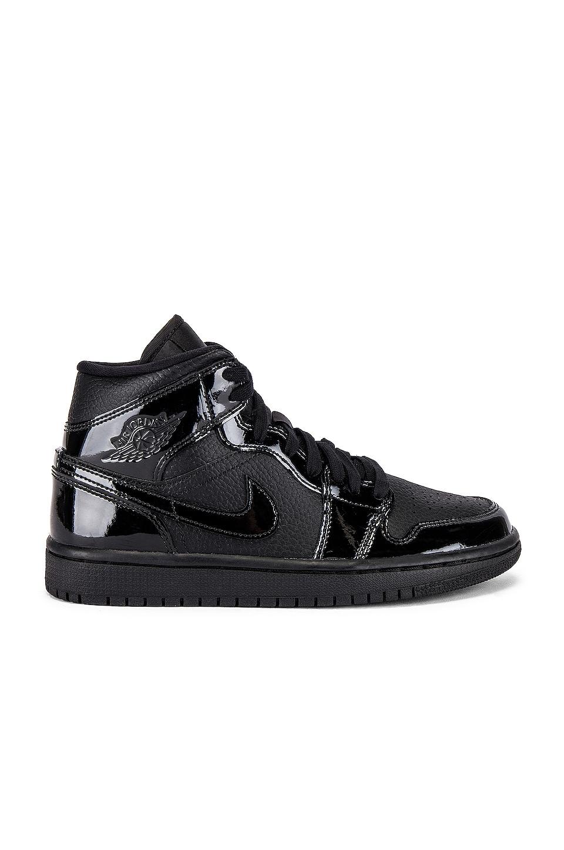 quality design ff637 148dc Jordan AJ 1 Mid Sneaker in Black | REVOLVE