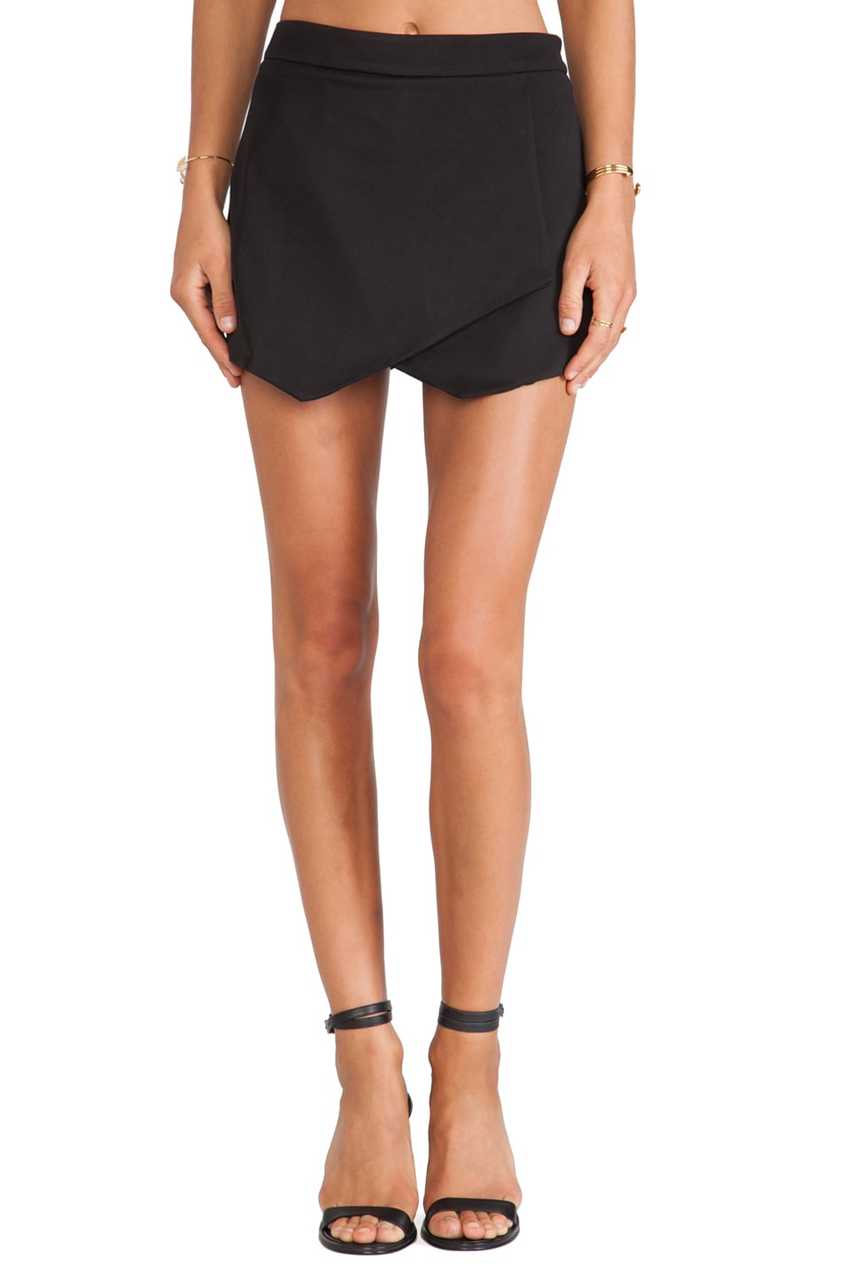 krisa Asymmetrical Mini Skirt in Black
