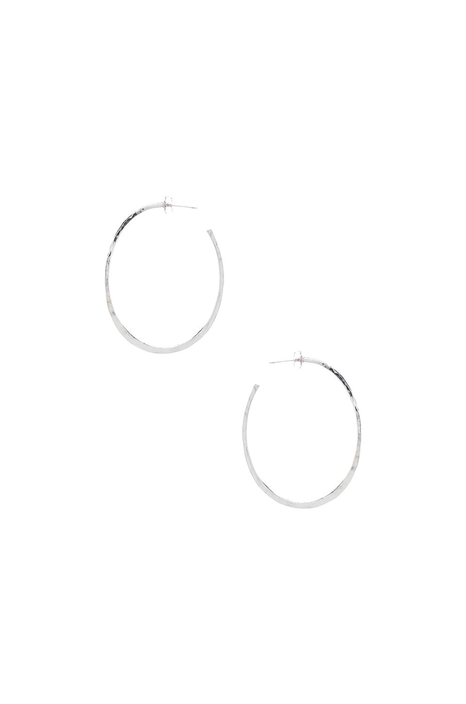 Natalie B Jewelry Huggy Hoop Earrings in Silver