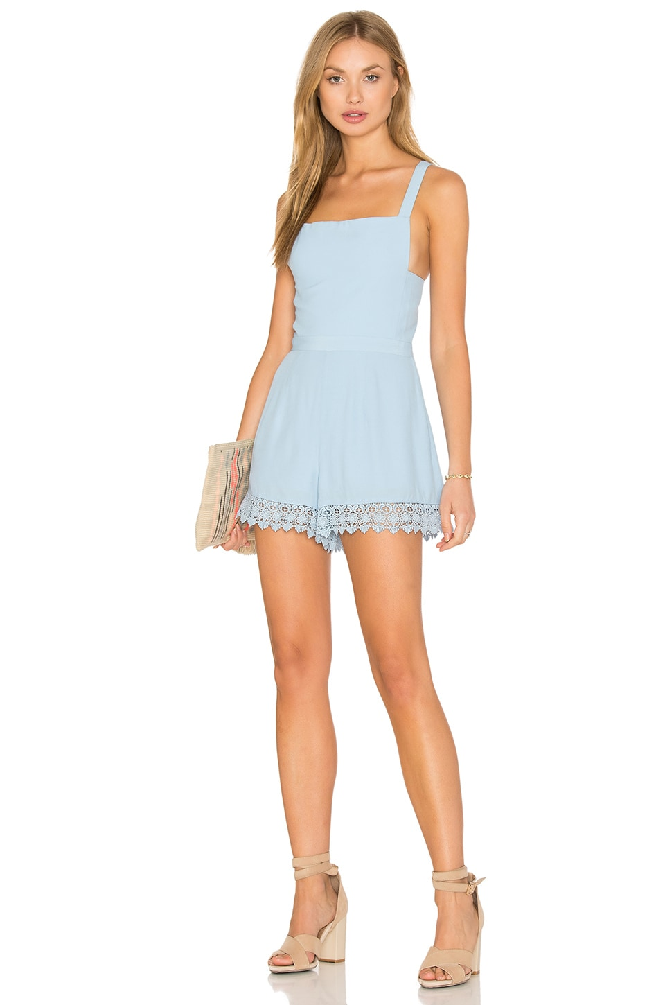 NBD x Naven Twins Take Care Apron Front Romper in Sky Blue