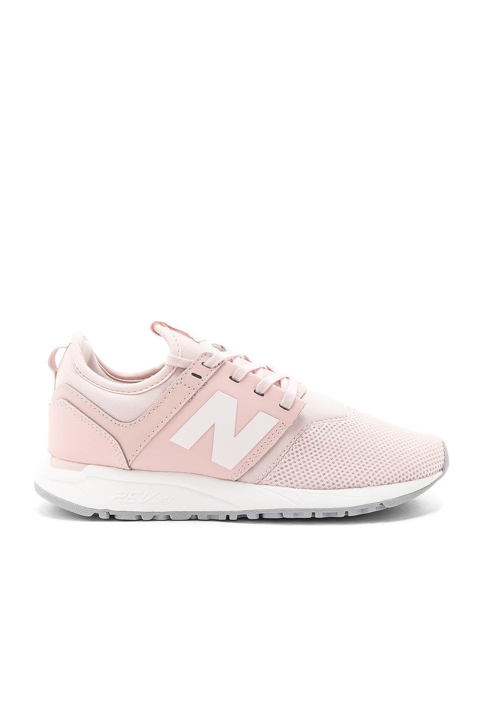 new balance 247 sneaker in pink sandstone white revolve. Black Bedroom Furniture Sets. Home Design Ideas