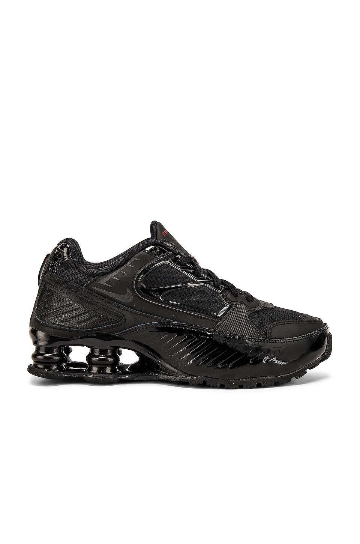 Nike Women's Shox Enigma Sneaker in Black & Gym Red