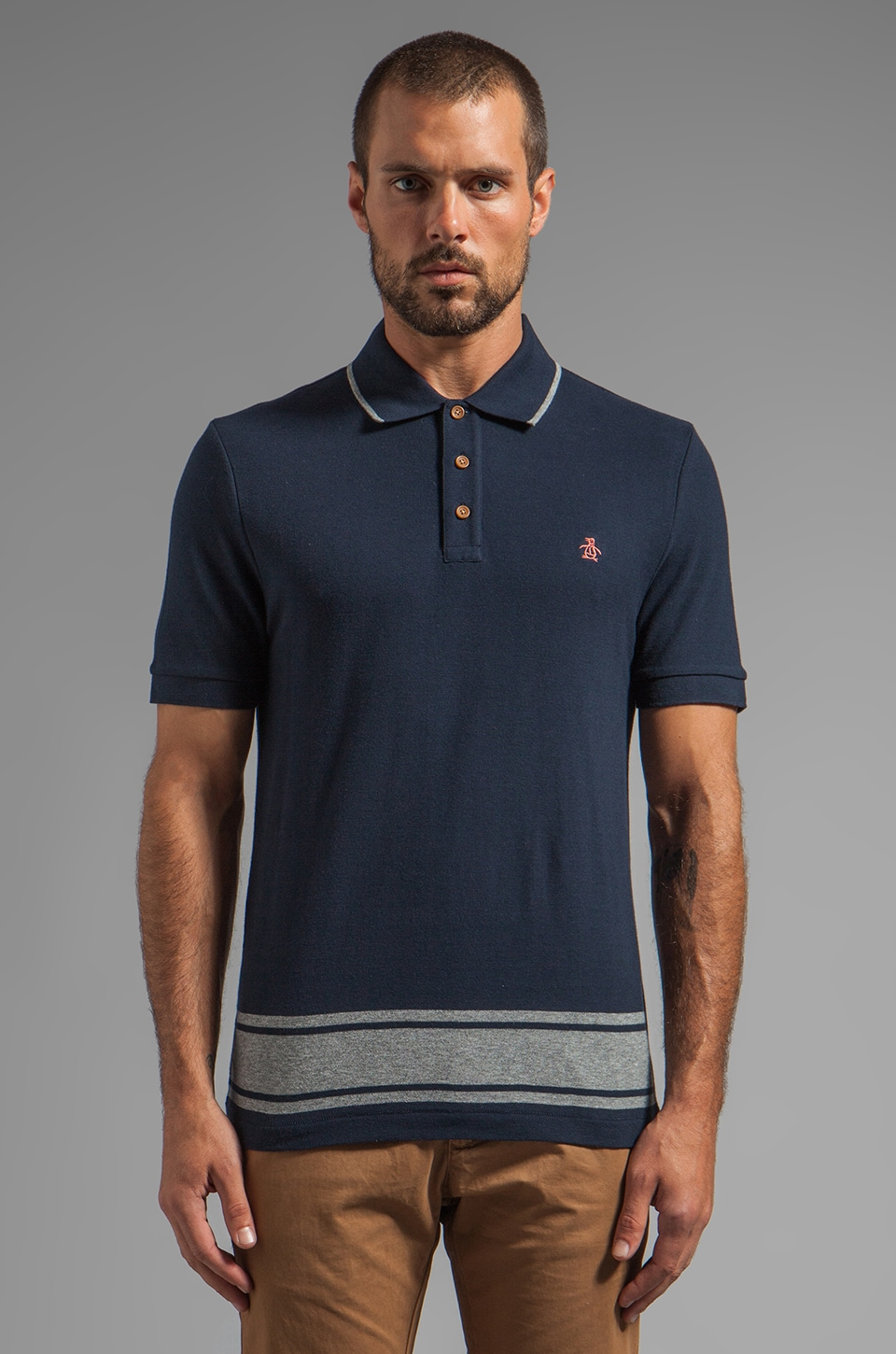 Penguin Engineered Stripe Hem Polo in Dark Sapphire