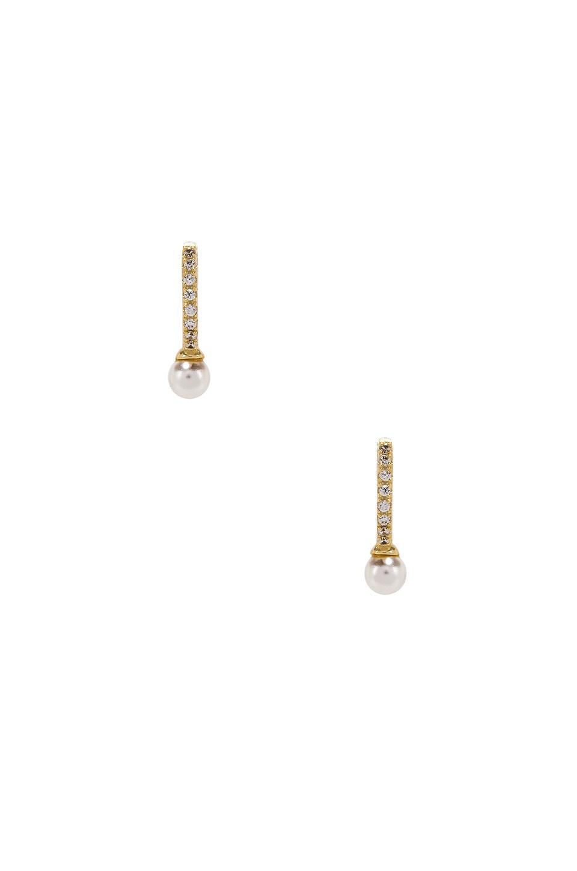 SHASHI Pearl Huggie Earrings in Gold