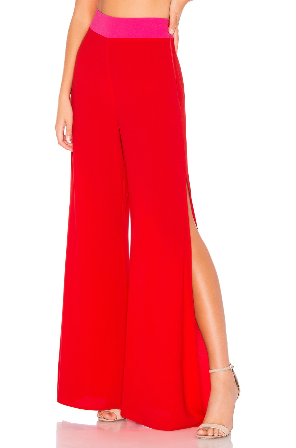 Show Me Your Mumu SHOW ME YOUR MUMU CAMPBELL HIGH SLIT PANT IN RED.