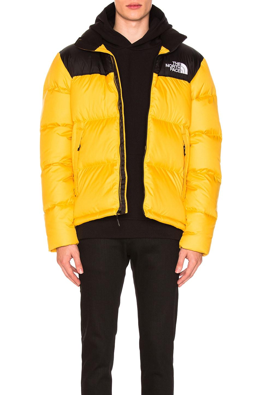 The North Face Novelty Nuptse Jacket in TNF Yellow | REVOLVE
