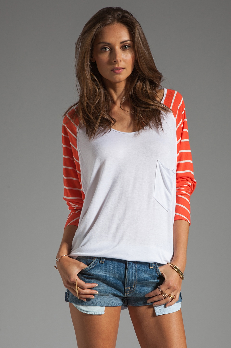 Tylie Stripe Sleeve Pocket Raglan Tee in Coral/White