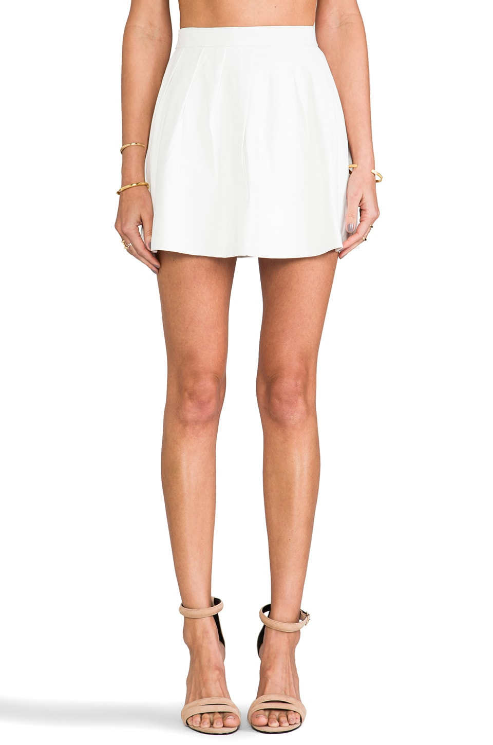 This is a Love Song Strike Plain Leather Mini Skirt in White