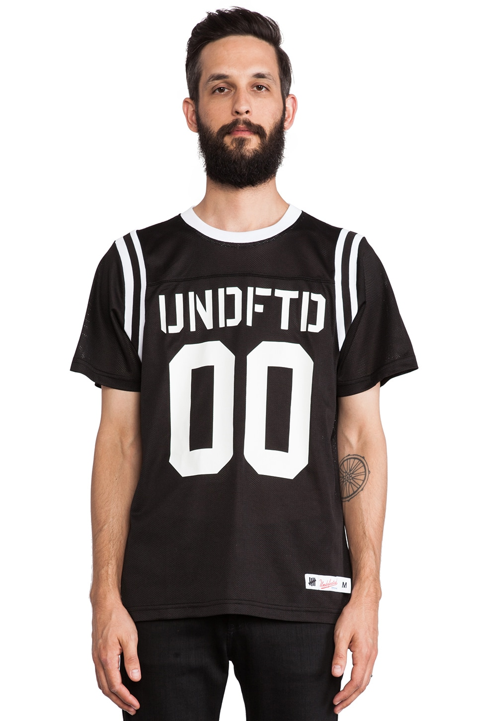 Undefeated 00 Mesh Football Tee in Black