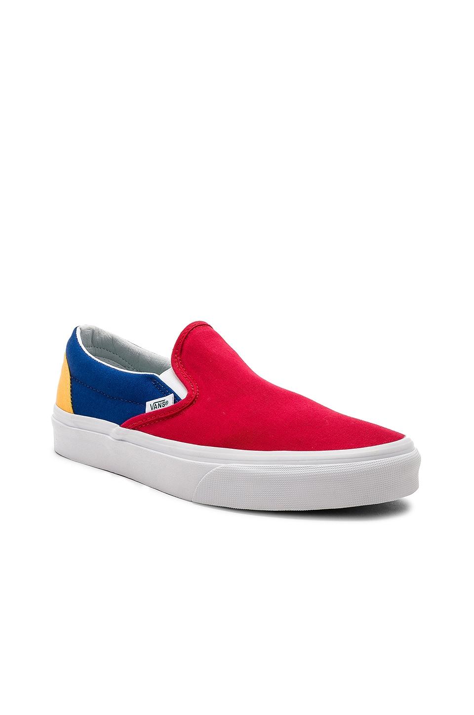 b1b3ab6b7933 Vans Yacht Club Classic Slip-On in Red   Blue   Yellow