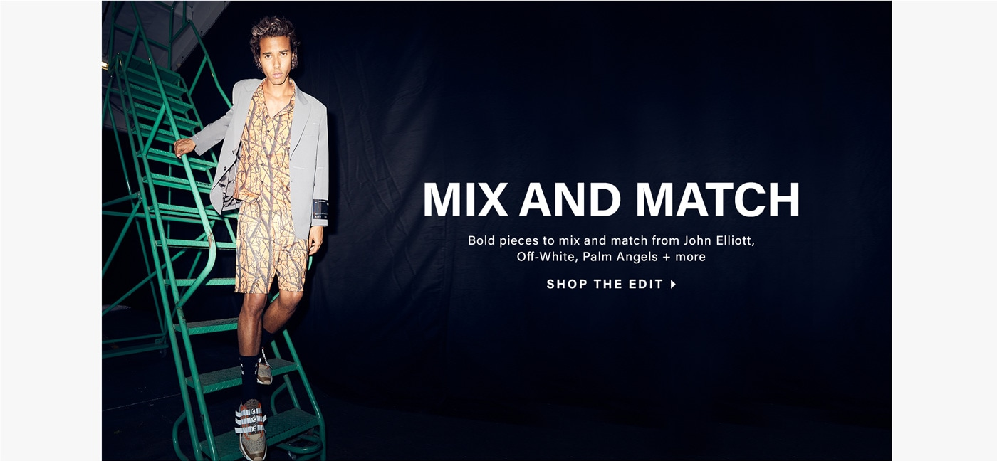 Male model wearing bold prints with blazer standing on a green ladder. Mix and match from John Elliott, Off-White, Palm Angels + more. Shop the Edit