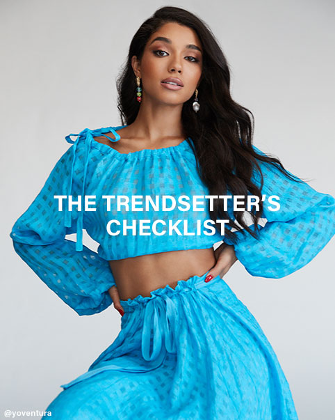 Yovanna Ventura poses in a blue matching crop top and midi skirt set. The Trendsetter's Checklist. A roundup of the top trends we can't live without this season. Shop the Edit.