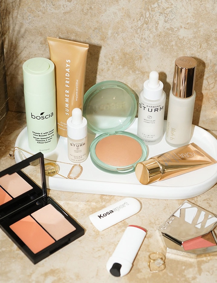 An array of clean beauty products laid out on a countertop. Shop Clean Beauty.