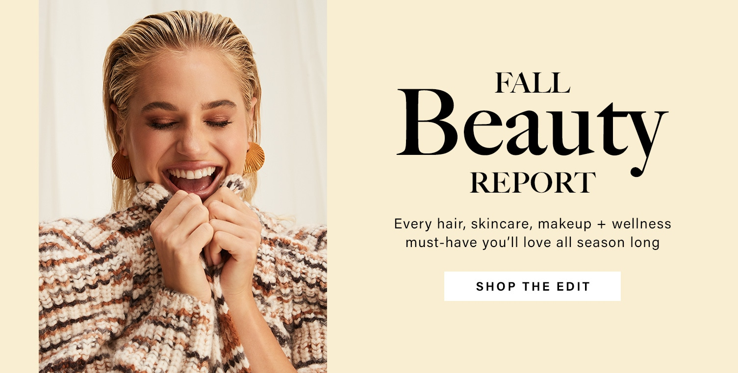 A model with wet-textured pulled back hair smiles widely with closed eyes featuring warm toned eyeshadow, dark defined brows, and neutral lips. Fall Beauty Report. Every hair, skincare, makeup + wellness must-have you'll love all season long. Shop the Edit.