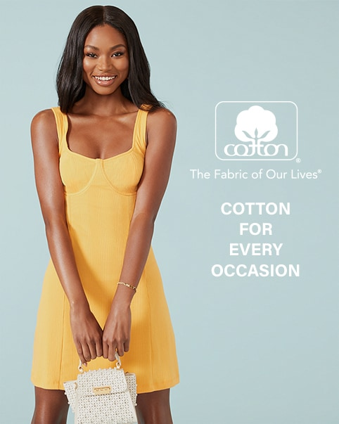A model is standing in front of a blue background wearing a yellow tank dress. Cotton for Every Occasion. Enter the Cotton Shop.