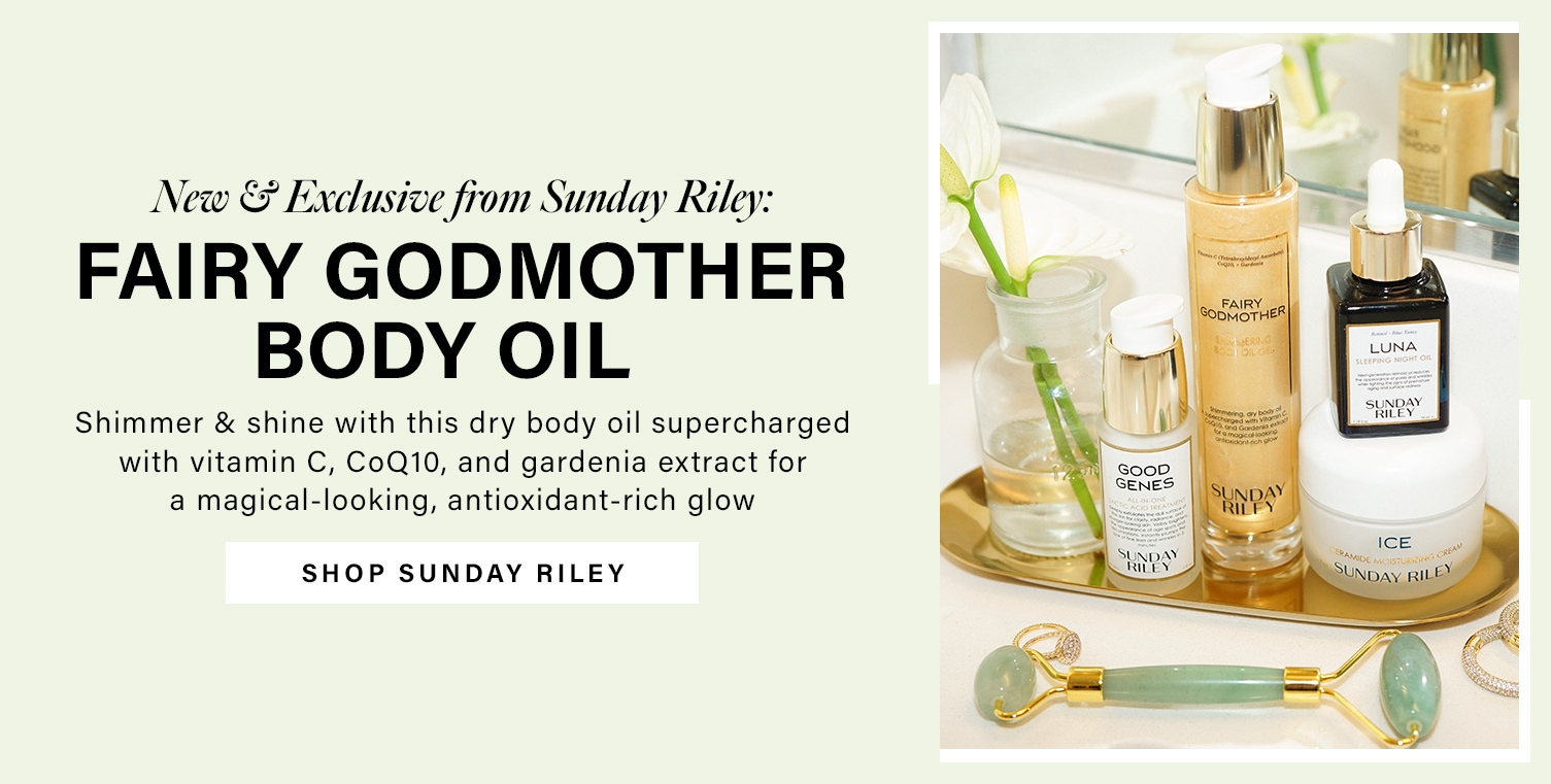 Sunday Riley beauty products are lined up on a gold oval tray on a beauty vanity, featuring Good Genes, Fairy Godmother, Luna, and Ice. New & Exclusive from Sunday Riley: Fairy Godmother Body Oil. Shimmer & shine with this dry body oil supercharged with vitamin C, coQ10, and gardenia extract for a magical-looking, antioxidant-rich glow. Shop Sunday Riley.