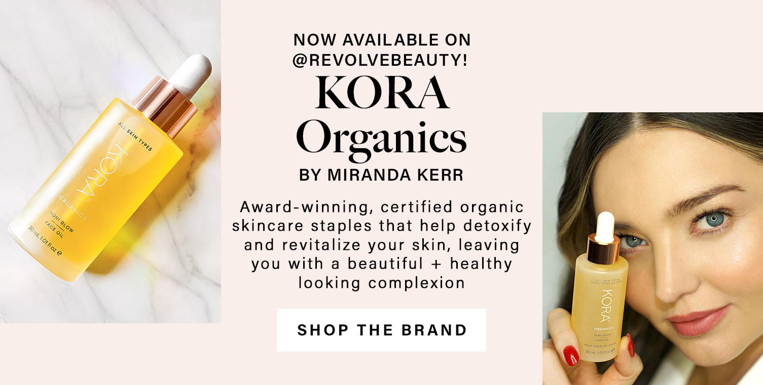A bottle of Kora Organics None Glow face oil sits on a marble surface. Miranda Kerr holds the bottle close to her face. Now available on @REVOLVEBEAUTY! KORA Organics by Miranda Kerr. Award-winning, certified organic skincare staples that help detoxify and revitalize your skin, leaving you with a beautiful + healthy looking complexion. Shop Kora Organics.