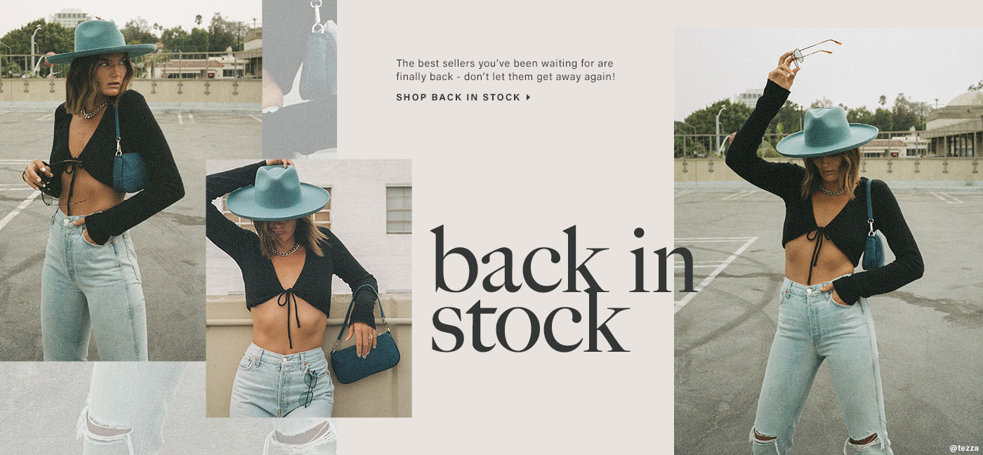 Tezza Barton is outdoors wearing a blue hat, a black long sleeve crop top with a front tie detail, blue jeans, and carrying a blue purse. Shop Back in Stock.