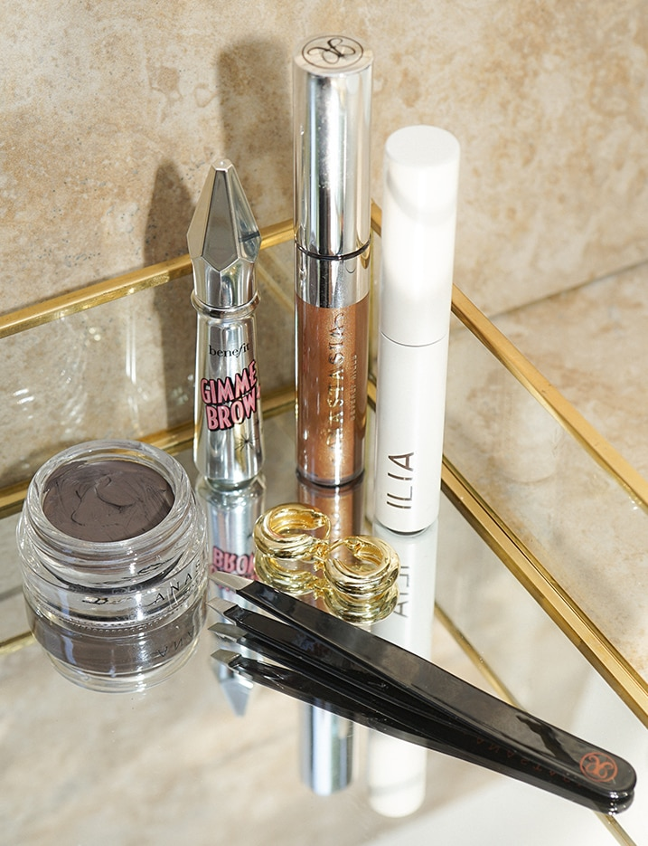 A variety of brow defining products sit in a glass dish. Shop eyebrows.