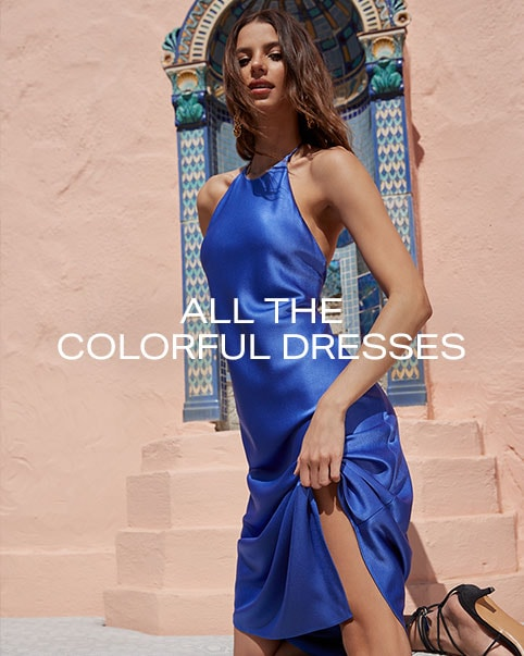 A model wearing a royal blue sleeveless mini dress. A model sitting under a window wearing a royal blue sleeveless mini dress. All the Colorful Dresses. Shop the Edit.