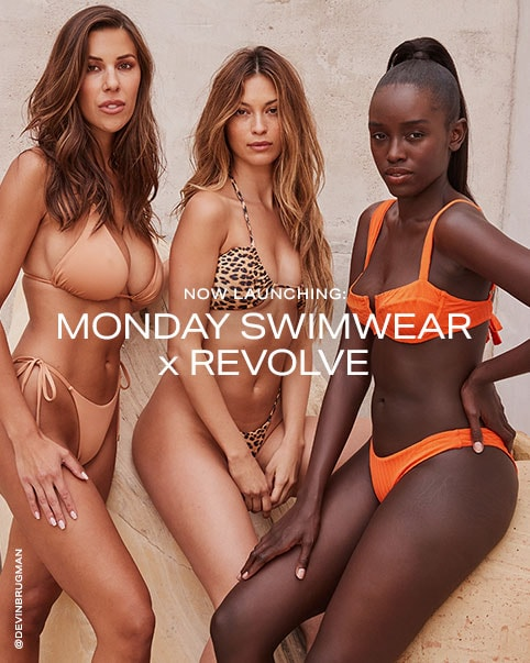 Devin Brugman wearing a nude colored bikini top and matching bikini bottoms, a model wearing a leopard print bikini top and matching bikini bottoms, a model wearing an orange bikini top and matching bikini bottoms. Natasha Oakley lying on a rug next to wicker chairs wearing a nude colored bikini top and matching bikini bottoms. Natasha Oakley wearing a leopard print bikini top and matching bikini bottoms. A close-up photo of a model wearing a ribbed orange bikini top. Now Launching: Monday Swimwear x REVOLVE. Shop the Collection.
