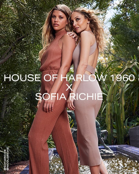 Sofia Richie wearing a brown sleeveless jumpsuit. Nicole Richie wearing a taupe sleeveless midi dress with strappy back. Nicole Richie sitting wearing a white short sleeve crochet dress. A model sitting wearing a tan sleeveless jumpsuit. A model sitting wearing a white long sleeve crop top with tie front. Sofia Richie sitting wearing an orange and  white tie dye long sleeve shirt, a tan bikini top, and orange and white tie dye shorts. House of Harlow 1960 x Sofia Richie. Shop the Collection.