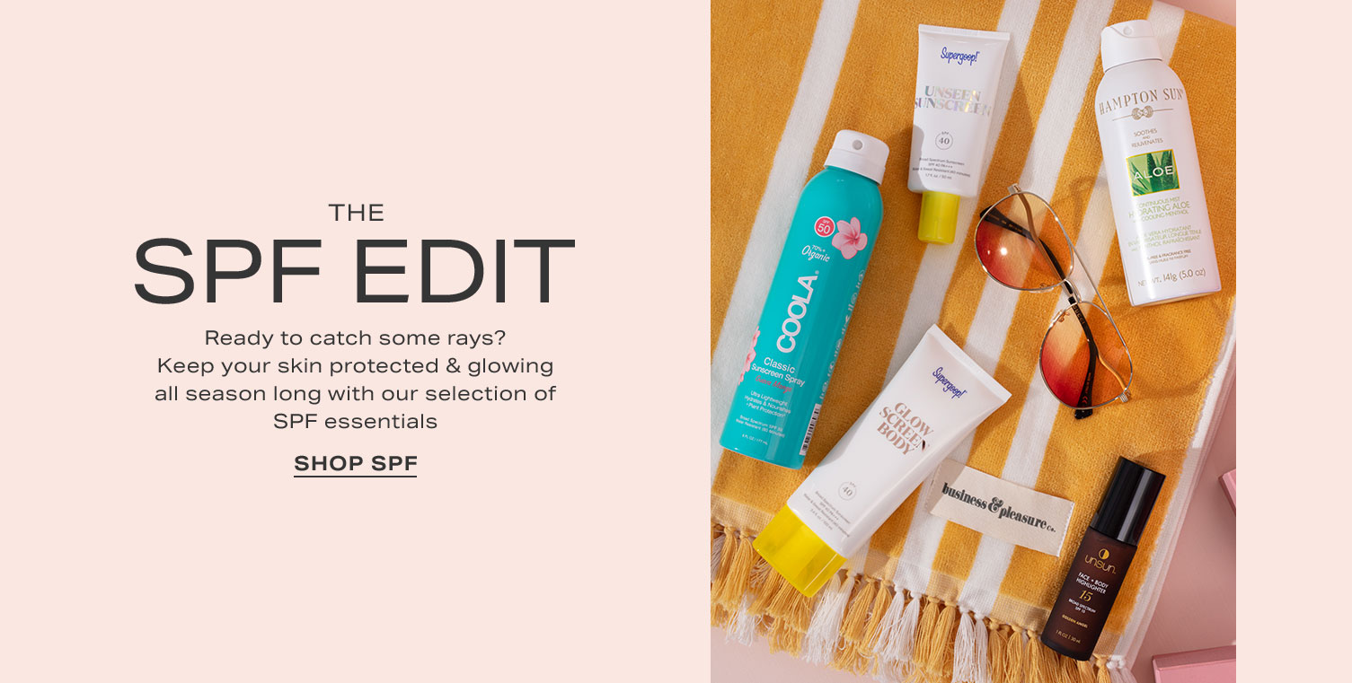 SPF and suncare products lay scattered on an orange and white beach towel. The SPF Edit. Ready to catch some rays? Keep your skin protected & glowing all season long with our selection of SPF essentials. Shop Now.