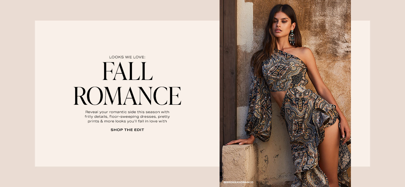A model wearing a one shoulder dress with a paisley print, side cut-out and asymmetrical hem. Looks We Love: Fall Romance. Shop the Edit.